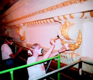 "The process of applying ""Flash"" gilding in the Grand Salon of the Renwick Gallery required workers to wear dust masks, to prevent inhalation of mica powder."
